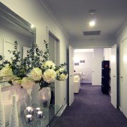 View of hallway at this David Reid show ceiling, floristry, flower, home, interior design, real estate, gray