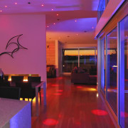 View of a house which features the C-Bus ceiling, flooring, function hall, interior design, light, lighting, lobby, purple, red