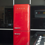 View of kitchen which features a Smeg 50s red, refrigerator, black, red