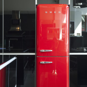View of kitchen which features a Smeg 50s furniture, home appliance, major appliance, product design, red, refrigerator, black, red