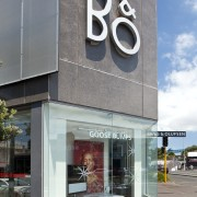 Exterior view of the Bang & Olufsen shop. architecture, building, commercial building, corporate headquarters, facade, gray
