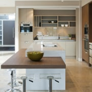 View of a kitchen designed by Suyin of countertop, cuisine classique, floor, flooring, interior design, kitchen, table, wood flooring, gray