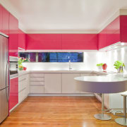 View of a kitchen which features pink coloured cabinetry, countertop, floor, interior design, interior designer, kitchen, room, gray, red