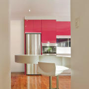 View of a kitchen which features pink coloured ceiling, floor, flooring, furniture, hardwood, interior design, kitchen, laminate flooring, living room, product design, shelf, shelving, table, wall, wood flooring, gray, orange