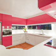 View of a kitchen which features pink coloured cabinetry, countertop, interior design, interior designer, kitchen, product design, real estate, room, white