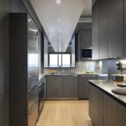 View of an apartment kitchen with dark-toned cabinetry, architecture, cabinetry, ceiling, countertop, cuisine classique, floor, interior design, kitchen, black, gray