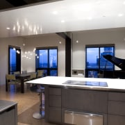 View of an apartment kitchen with dark-toned cabinetry, countertop, interior design, kitchen, room, black, gray