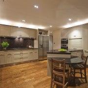 View of kitchen which features brown granite benchtops, cabinetry, countertop, cuisine classique, floor, flooring, hardwood, interior design, kitchen, laminate flooring, real estate, room, wood flooring, brown