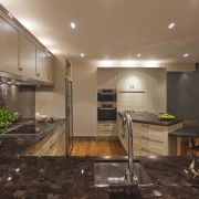 View of a kitchen which features timber floors, ceiling, countertop, flooring, interior design, kitchen, real estate, brown