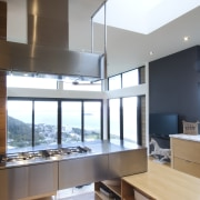 Raised floor kitchen. Stainless steel Binova cooktop. American architecture, daylighting, interior design, kitchen, white, gray