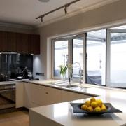 View of a renovated show home kitchen designed countertop, cuisine classique, interior design, kitchen, real estate, window, brown, white