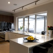 View of a renovated show home kitchen designed countertop, cuisine classique, interior design, kitchen, real estate, room, window, brown