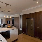 View of a renovated show home kitchen designed ceiling, flooring, interior design, kitchen, property, real estate, room, brown