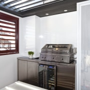View of an outdoor kitchen which features a home appliance, interior design, kitchen, major appliance, white