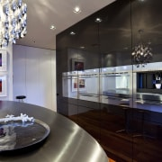 View of a kitchen which features an oval-shaped countertop, interior design, kitchen, room, black, gray