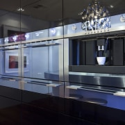 View of a kitchen which features an oval-shaped display case, glass, interior design, kitchen, black