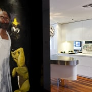 View of kitchen with wooden flooring and painting. art exhibition, boutique, exhibition, interior design, room, gray, black