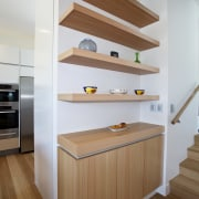 View of a kitchen built by RH Cabinetry cabinetry, countertop, floor, flooring, furniture, hardwood, interior design, kitchen, laminate flooring, plywood, product design, room, shelf, shelving, stairs, wall, wood, wood flooring, brown, gray