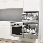 View of a minimal kitchen which features white furniture, home appliance, kitchen appliance, product, product design, white