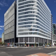 The Asteron Centre in Wellington, designed by Warren apartment, architecture, building, city, commercial building, condominium, corporate headquarters, daytime, downtown, facade, headquarters, landmark, metropolis, metropolitan area, mixed use, neighbourhood, plaza, real estate, residential area, sky, skyscraper, tower block, urban area, gray
