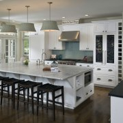 View of kitchen with wooden flooring, white cabinetry cabinetry, countertop, cuisine classique, floor, flooring, hardwood, interior design, kitchen, room, wood flooring, gray, black