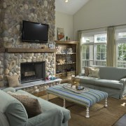 View of living room with river rock fireplace. home, interior design, living room, property, real estate, room, gray