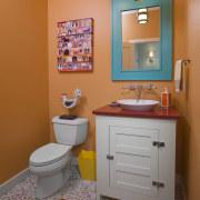 View of bathroom with orange walls and blue bathroom, bathroom accessory, bathroom cabinet, home, interior design, orange, plumbing fixture, room, brown, gray