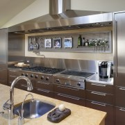 View of stainless steel cabinetry, hood, fridge and cabinetry, countertop, cuisine classique, home appliance, interior design, kitchen, gray, brown
