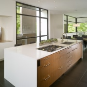 View of island with white countertop, wooden cabinetry cabinetry, countertop, cuisine classique, interior design, kitchen, real estate, room, gray, brown