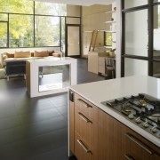 View of kitchen with wooden cabinetry and white cabinetry, countertop, cuisine classique, floor, flooring, interior design, kitchen, room, gray