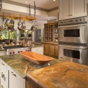 View of remodeled kitchen with rainforest green marble cabinetry, countertop, cuisine classique, interior design, kitchen, brown, orange