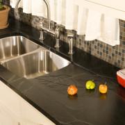 View of remodeled kitchen in a California bungalow, countertop, floor, flooring, granite, interior design, kitchen, sink, tile, brown, orange
