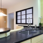 View of kitchen and dining area with Japanese countertop, interior design, kitchen, real estate, room, table, gray