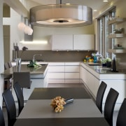 View of neutral-toned kitchen and dining space, featuring countertop, interior design, kitchen, room, gray