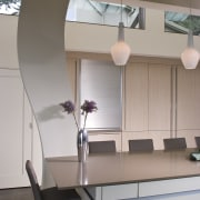 View of neutral-toned kitchen and dining space, featuring architecture, ceiling, daylighting, furniture, interior design, product design, table, gray