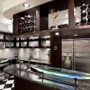 View of kitchen in Art-Deco styled apartment building, countertop, interior design, kitchen, gray, black
