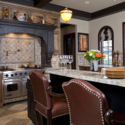 View of kitchen with aged look, featuring internally cabinetry, countertop, cuisine classique, dining room, home, interior design, kitchen, living room, room, red, gray
