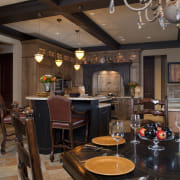 View of kitchen with aged look, featuring internally ceiling, countertop, dining room, interior design, restaurant, room, table, black, brown