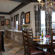 View of kitchen with aged look, featuring internally dining room, furniture, interior design, restaurant, room, black, gray