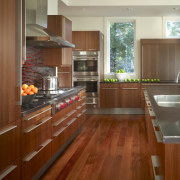 View of a kitchen which combines commerical touches cabinetry, countertop, cuisine classique, floor, flooring, hardwood, interior design, kitchen, laminate flooring, real estate, room, wood, wood flooring, wood stain, brown