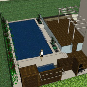 The rear yard of this home has been architecture, area, games, grass, house, property, real estate, residential area, roof, green, gray