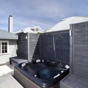 The rear yard of this home has been architecture, daylighting, house, roof, swimming pool, teal