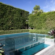 The rear yard of this home has been estate, house, leisure, plant, real estate, reflection, sky, swimming pool, tree, vacation, villa, water, teal
