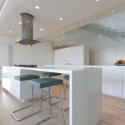 View of penthouse with white walls and a architecture, cabinetry, ceiling, countertop, floor, flooring, interior design, kitchen, product design, real estate, room, gray