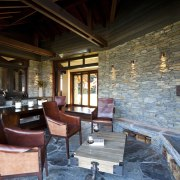 View of lounge area with stone wall feature. interior design, living room, real estate, black