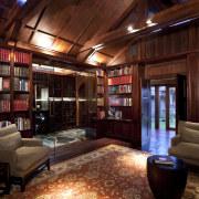 View of library room with wooden walls and bookcase, home, institution, interior design, library, living room, lobby, red