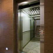View of lift in contemporary home. - View architecture, daylighting, door, glass, house, interior design, lobby, window, brown