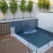 View of pool with water feature and deck leisure, outdoor structure, property, swimming pool, water, gray