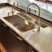 View of kitchen with hood by Zephyr Ventilation, countertop, kitchen, plumbing fixture, sink, tap, brown