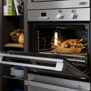 View of the new indoor kitchen collection by gas stove, home appliance, kitchen appliance, kitchen stove, major appliance, microwave oven, oven, black